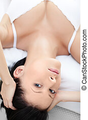 Woman in underwear is lying in the spacious bed - Woman in...
