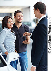 Seller and buyer - Seller gives the buyer of the car keys