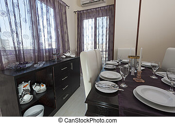 Dining table in a luxury apartment - Dining room with table...