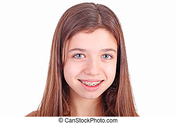 Beautiful young teen girl with brackets on teeth in white