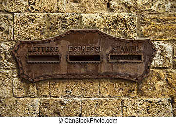 the letter box - old letter box on the wall of the house
