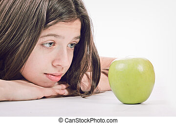 happy smiling young woman rith green fresh apple