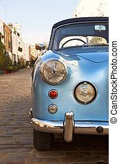 Vintage car - Blue vintage car parked in a paved street