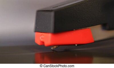Macro of cartridge, stylus lifting - Macro of cartridge and...