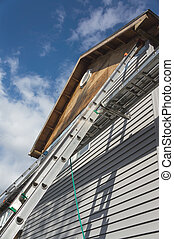 Exterior Home Repairs - Ladders leaning against home...
