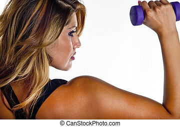 Woman Lifting Weights - Woman exercising with dumbell...