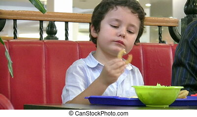 Little boy in fast food restaurant