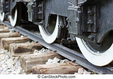Train wheels on track - Close up image of old vagon wheels