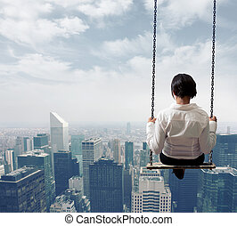 Businesswoman on a swing - Freedom business woman on a swing