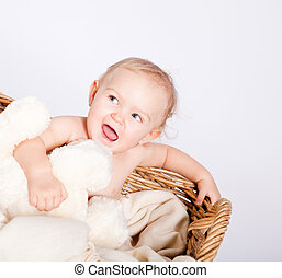 cute little baby infant in basket with teddy