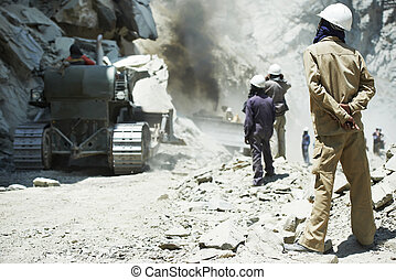 Hindu indian builders workers at construction site - Two...