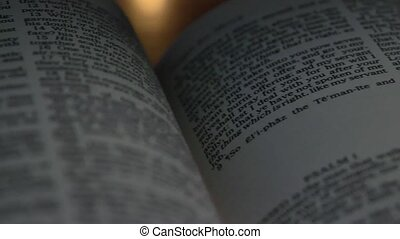 Bible-Psalms - A slow, shallow depth of field, candle lit...