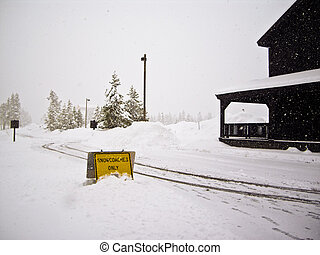 Snowcoaches Only Sign in snowstorm Yellowstone - April...