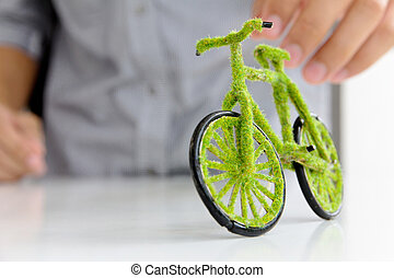 Eco bicycle icon - Hand Holding Eco bicycle icon,energy...