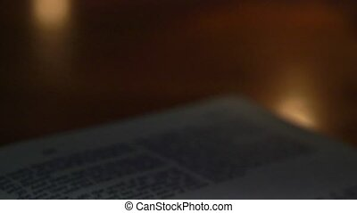Bible-Exra - A slow, shallow depth of field, candle lit pan...