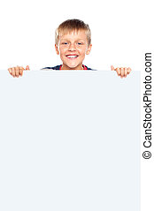 Young boy hiding behind big whiteboard ad Business concept