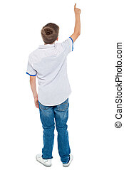Rear view of a school boy pointing upwards - Rear view of a...