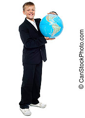 Smart looking young kid holding globe