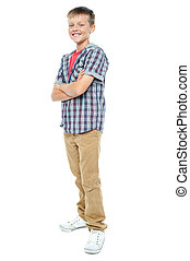 Confident young casual 12 years old boy posing in style with...