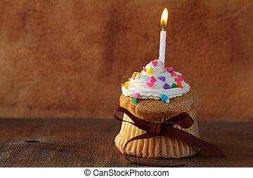 cupcake with a candle and cream - cupcake with a candle and...