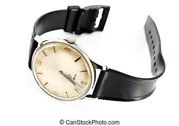 Old broken wristwatch with black strap isolated on white