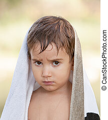 three year old boy with a serious expression - Portrait of a...