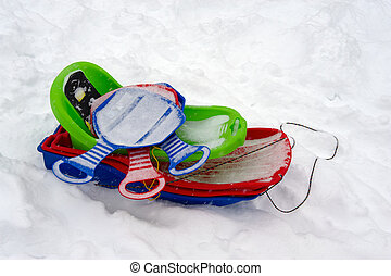 Sledge - The multi-coloured childrens sledge forgotten on a...