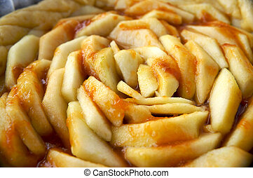 close-up view of an apple pie with jam