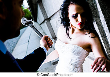 abused woman - Man attacking abused female bride with monkey...