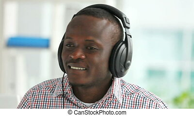 Nice beat - African-American guy listening to the music...
