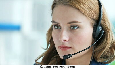 Telecom lady - Close-up of a helpline service operator doing...