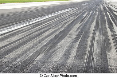 Skid marks on runway
