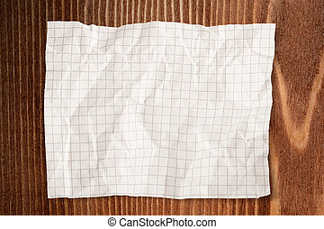 Paper Crumpled on wood background