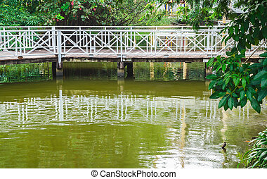 wooden bridge - White wooden bridge over a pond