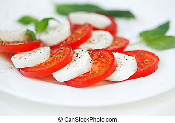 Caprese - Italian salad with cherry tomatos and mozarella...