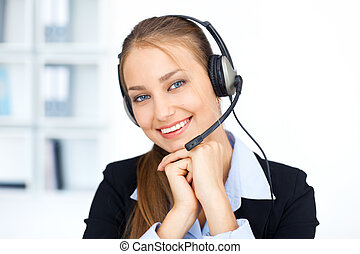 Portrait of pretty young female operator