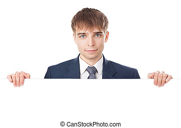 young smiling businessman holding white blank board isolated...