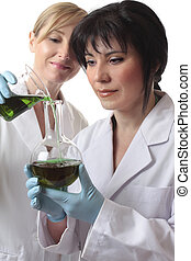 Chemists doing research - Two female chemists at work in the...