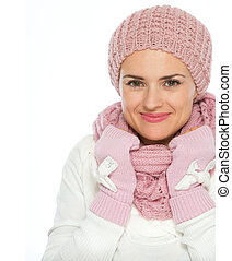 Portrait of happy woman in knit scarf, hat and mittens