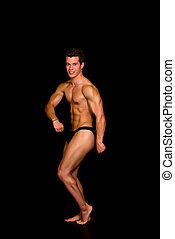 Body Builder, contest pose - Young attractive male body...