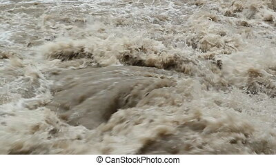 Flood river. Turbulent water.