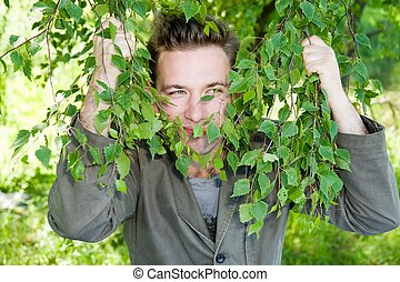 man in green - young man in green branches