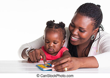 Reading time - The mother is teaching her daughter some...