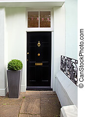 Black door - Black wooden entrance door on residential house