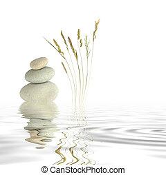 Zen Peace - Abstract of three natural grey pebbles balanced...