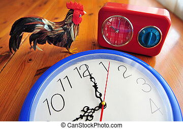 Daylight saving time DST - A rooster with an old clocks show...