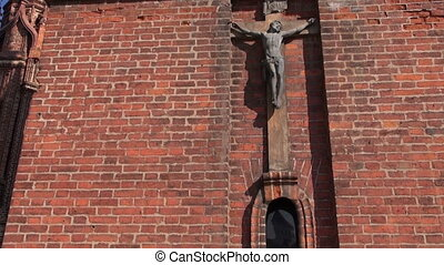 crucifix on old red church wall - crucifix on old red bricks...