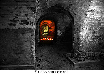 Empty abandoned dungeon with red candles light