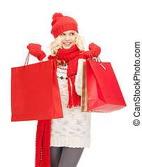 young girl with shopping bags - picture of young girl with...
