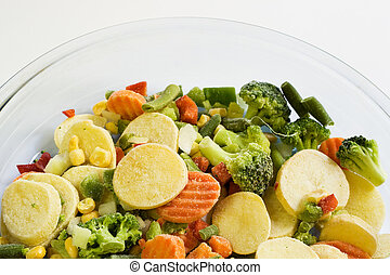 Frozen vegatables - Frozen vegetables in glass dish ready...